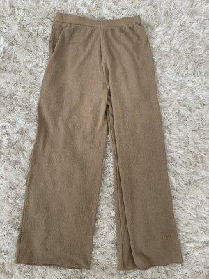 Zara Spodnie biodrówki kremowy-w kolorze białej wełny