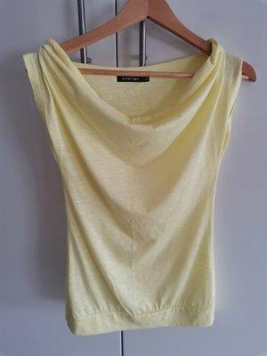 Jennifer Taylor Camisa con cuello V amarillo