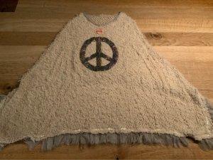 sommerlicher poncho mit fransen von yippie hippie und mit glitzerndem peace zeichen