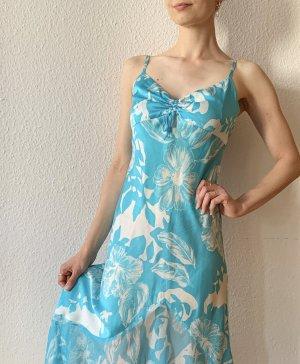 Sommerliches Seidenkleid von Naf Naf in türkis mit Volants