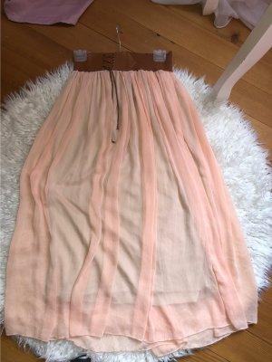 Falda de seda color rosa dorado