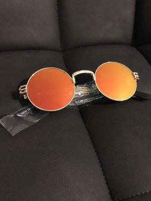 Gafas color oro-magenta