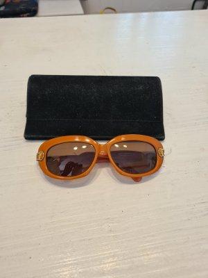 Swarovski Lunettes de soleil ovales orange-orange fluo