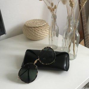Owalne okulary przeciwsłoneczne czarny-złoto
