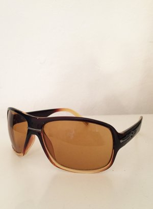 Sonnenbrille in braun und orange von Sundog Eyewear /  Mela Lens