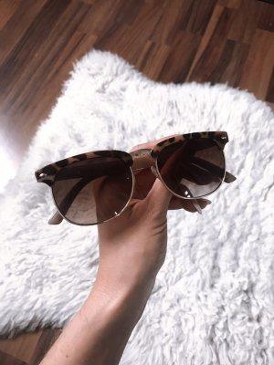 Sonnenbrille mit Leoparden Gestell