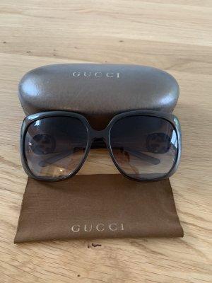 Gucci Hoekige zonnebril groen-grijs