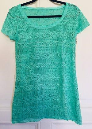 Camisa de malla turquesa