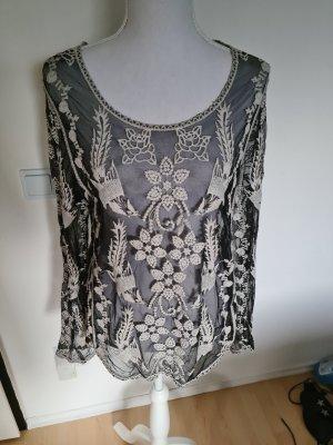 Blusa in merletto bianco-nero