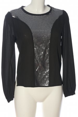 ST. Blusa brillante negro-color plata look casual