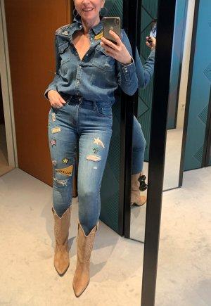 Starke Preissenkung!Levis Skinny Jeans Gr. 27 mit Comic Patches, neuwertig