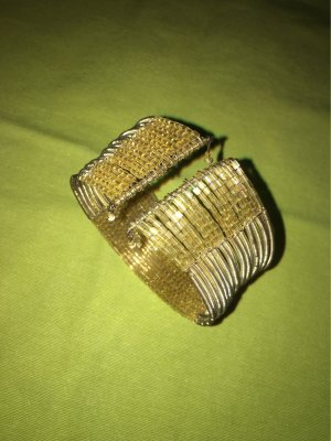 Six Armlet gold-colored