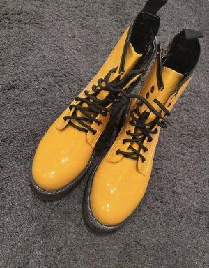 Botas con cordones amarillo-negro