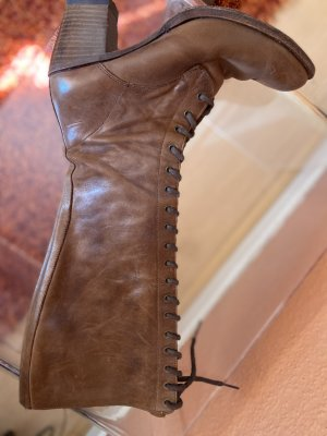 Botas con cordones color bronce Cuero