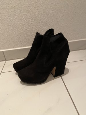 Miu Miu Slip-on Booties black
