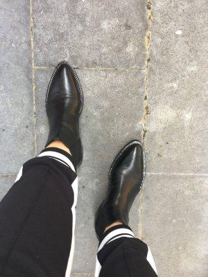 designed by Steffen Schraut Slip-on Booties black leather