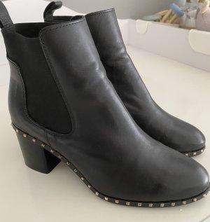 Alpe Woman Slip-on laarzen zwart-goud