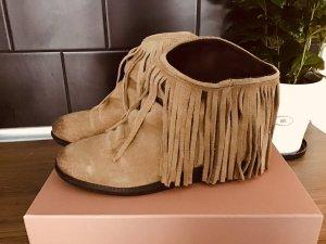 Botines estilo vaquero marrón claro