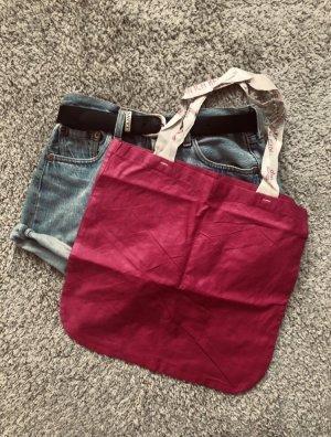 Bolso de tela rojo frambuesa