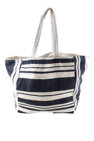 Bolso de tela crema-azul estampado a rayas look casual