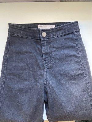 Stretch High Waist Jeans mit Rissen