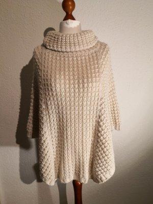 Poncho en tricot blanc cassé