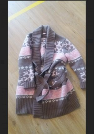 Manteau en tricot rose
