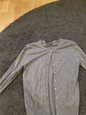 / Boléro en tricot gris