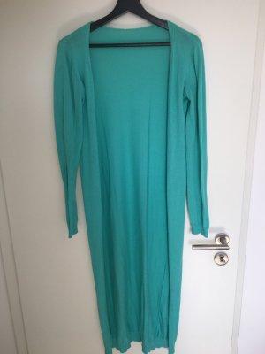 Manteau en tricot turquoise