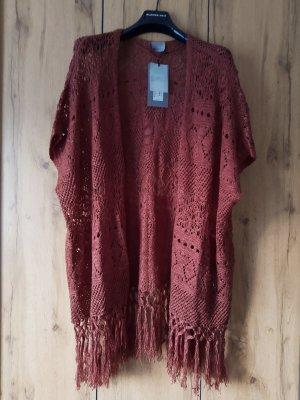 Poncho en tricot rouge carmin-bordeau polyester