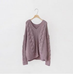 Veste tricotée en grosses mailles or rose