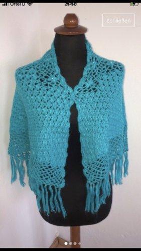 Poncho en tricot turquoise