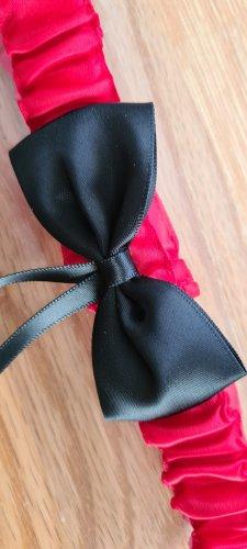 Strumpfband in schwarz-rot
