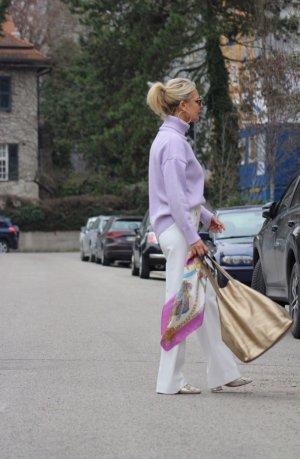 stylische goldene Beutel Tasche