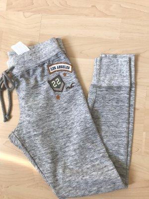 Hollister Spodnie dresowe jasnoszary
