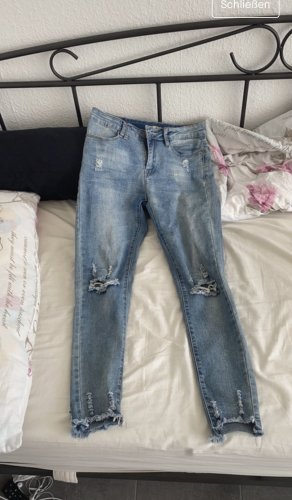 stylische Jeans ripped