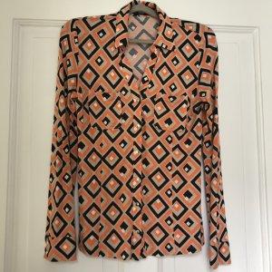 Stylische Jerseybluse im Prada-Look