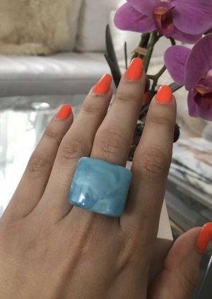 1.2.3 Paris Bague incrustée de pierres bleu clair