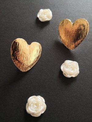 Süße Ohrringe, gold farbende, sehen echt süß aus am Ohr . Top.