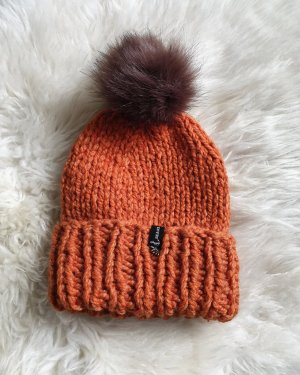 Hand made Chapeau en tricot orange