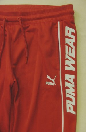 Supertolle, seltene Sporthose, Freizeit-,Trainingshose von PUMA..mit großem PUMA-Druck..orange..Größe DE 38