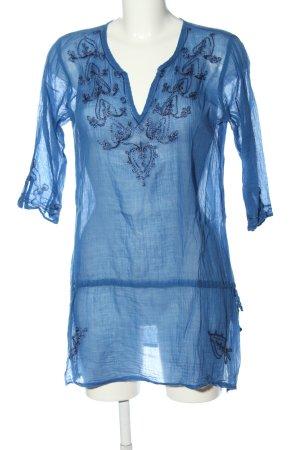 Suzanna Blusa larga azul look casual