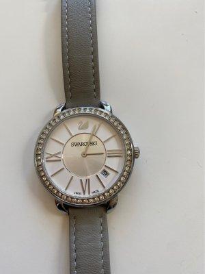 Swarovski Montre avec bracelet en cuir gris clair-gris