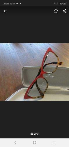 Swarovski Occhiale da sole rotondo rosso mattone