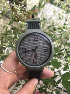 Swatch Montre analogue noir-kaki