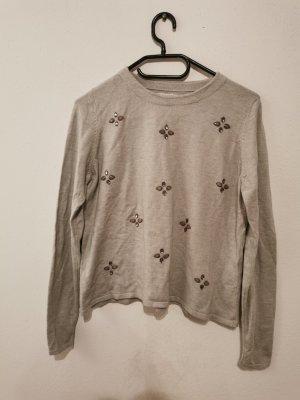 Sweater mit Applikationen