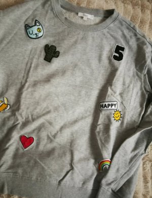 Sweater mit Patches