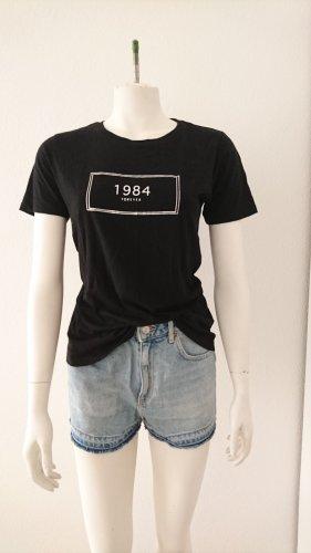 T-Shirt schwarz mit Glanzprint von forever 21, Gr. 36 (S)