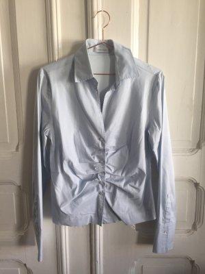 Taillierte Bluse mit dekorativer Raffung und Manschetten