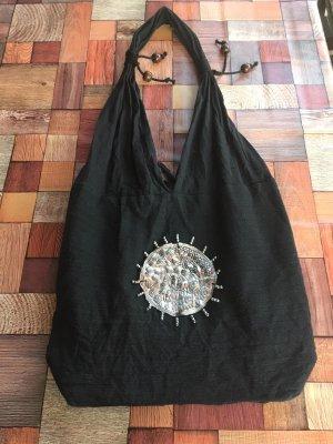 Bolso de tela negro-color plata